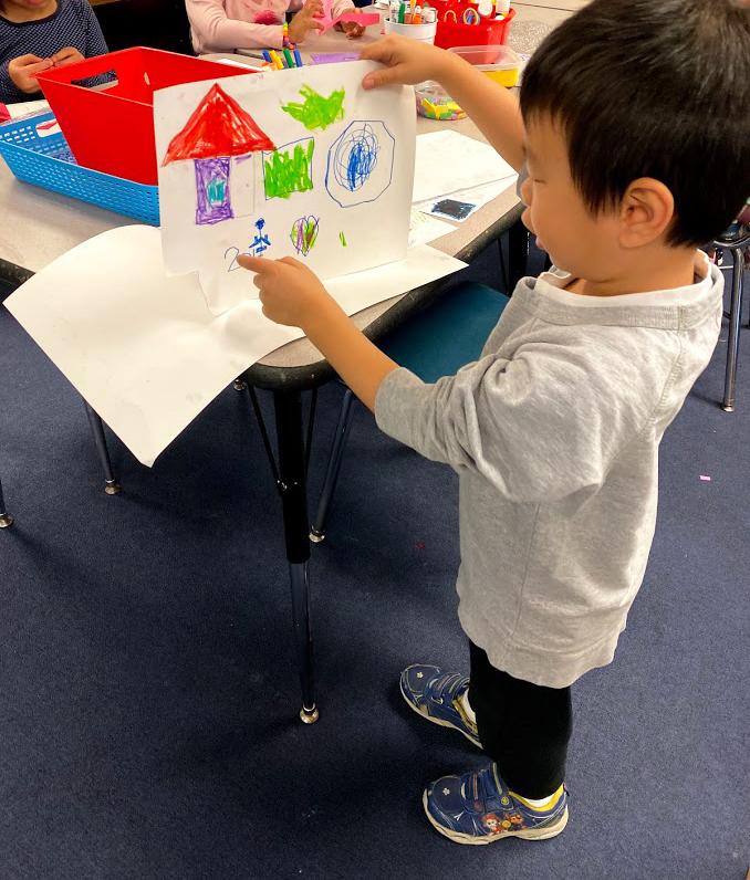 Kindergarten boy showing his story.