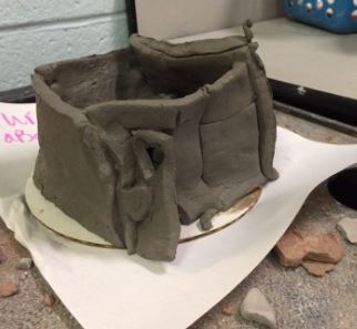 Clay house built by an elementary student.
