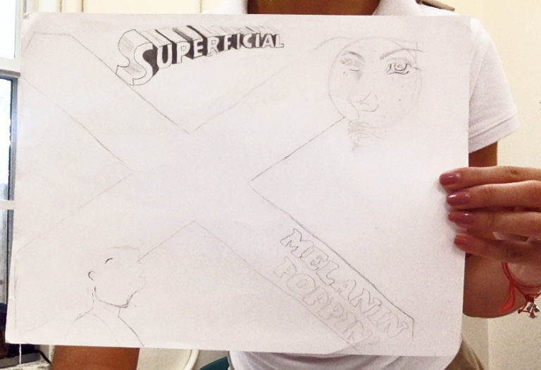 Middle school student sketching out ideas.